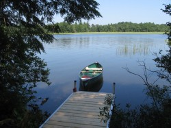 Dock and canoe on island
